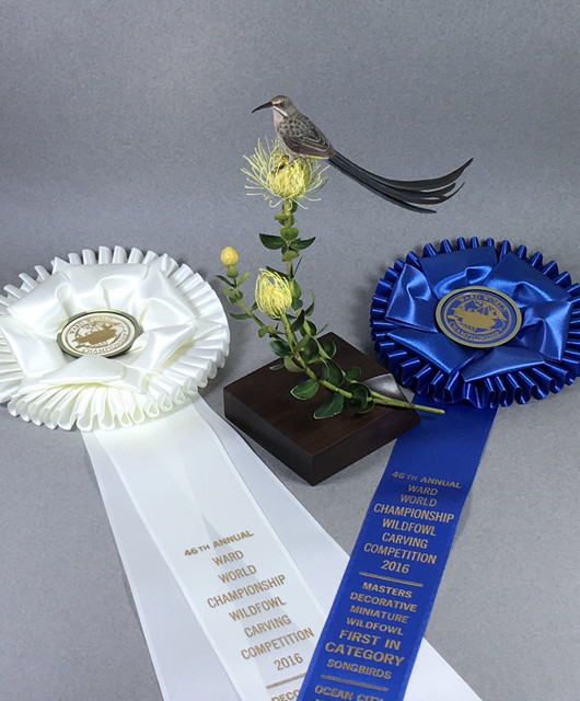 """""""Sweet"""" Cape Sugarbird and Protea flower First in Songbirds, Third in Masters Division, Ward World Carving Championship 2016"""